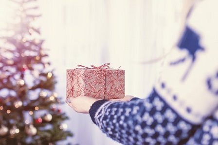 Carrying a Christmas gift