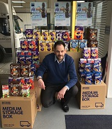 Man surrounded by Easter eggs
