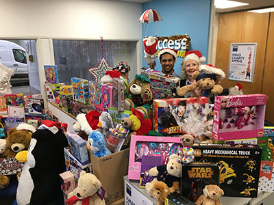 Two store team members behind hundreds of toys donated to Christmas charities