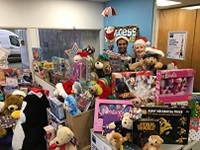Piles of Christmas gifts in Access Self Storage reception