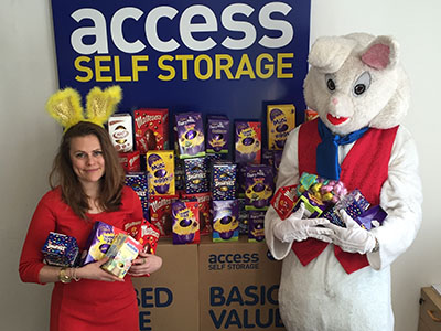Person wearing a Easter bunny costume and another Access Storage customer presenting the Easter campaign collections