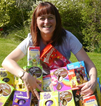 Woman holding collection of donated Easter eggs