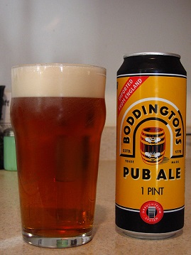 Boddingtons beer in glass and tin