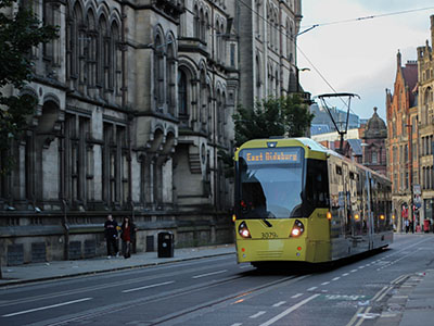 yellow and white tram