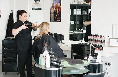Ladies hairdresser in action