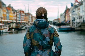 Woman looking over city canal