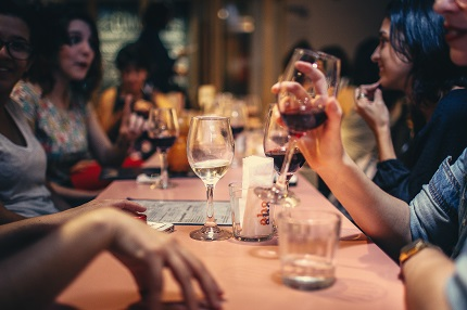 People around table enjoying a drink