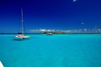 blue ocean with yachts