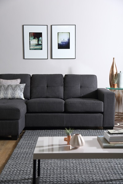 grey sofa by coffee table
