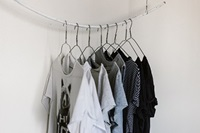 t-shirts hanging on wire hangers