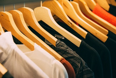t-shirts on wooden hangers