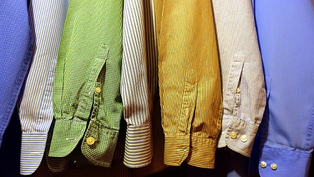 colourful shirts hanging in wardrobe
