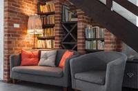 sofa's in alcove under stairs