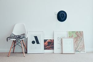group of paintings leaning against wall