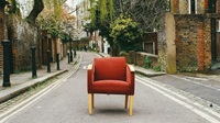 arm chair in middle of road