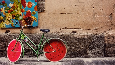 old colourful bike parked on pavement