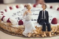wedding bride & groom figures sitting on cake