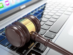 Auction hammer on laptop