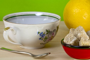 china teacup with bowl of sugar