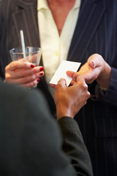 Business people exchanging business cards
