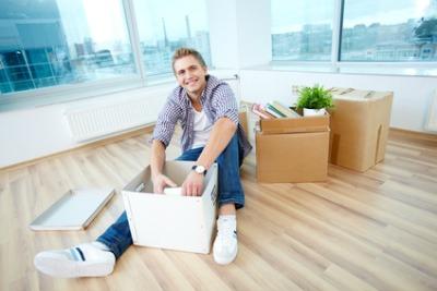 man unpacking a box