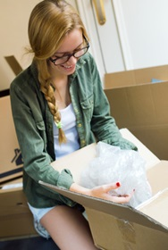 Girl packing a box