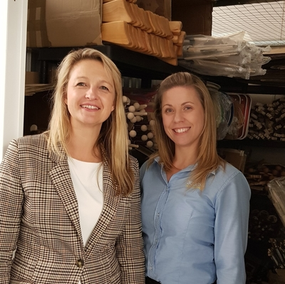 Owner of Green Owl Toys Izabela Hailey in her storage unit with and Access Self Storage team member Dee from Orpington Access Self Storage