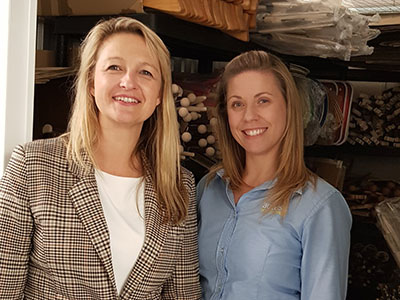 Owner of Green Owl Toys Izabela Hailey in her storage unit with an Access Self Storage team member Dee from Orpington Access Self Storage