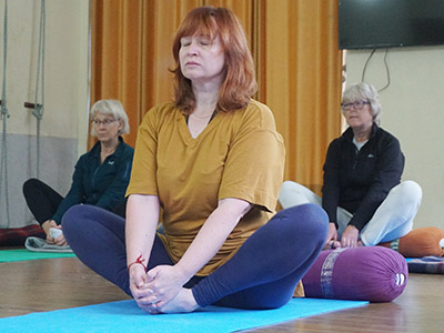 three women sitting in lotus position